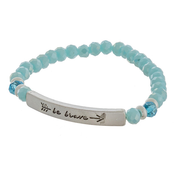 "Beaded stretch bracelet featuring a metal accent engraved with an arrow and the phrase ""Be Brave"". Approximately 2.5"" in diameter unstretched. Fits up to a 6"" wrist."