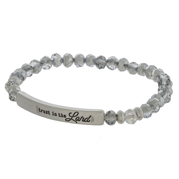 "Beaded stretch bracelet featuring ""Trust In The Lord"" inspiring focal. Approximately 2.5"" in diameter. Fits up to a 5"" wrist."