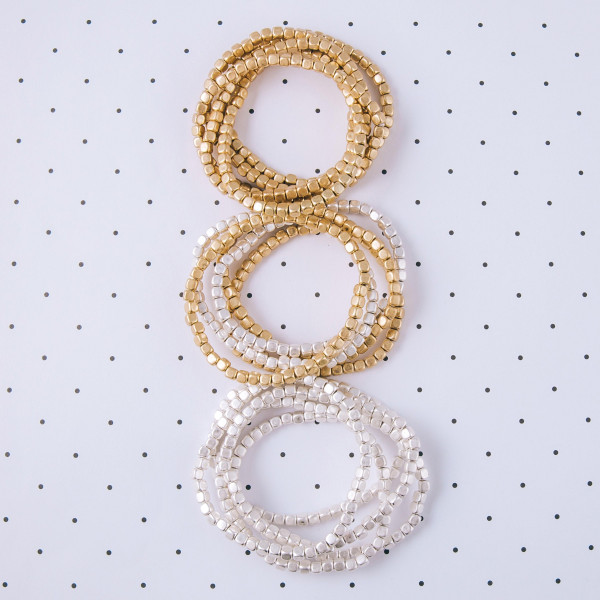 "Bracelet set featuring four beaded stretch bracelets. Approximately 3"" in diameter unstretched. Fits up to a 6"" wrist."