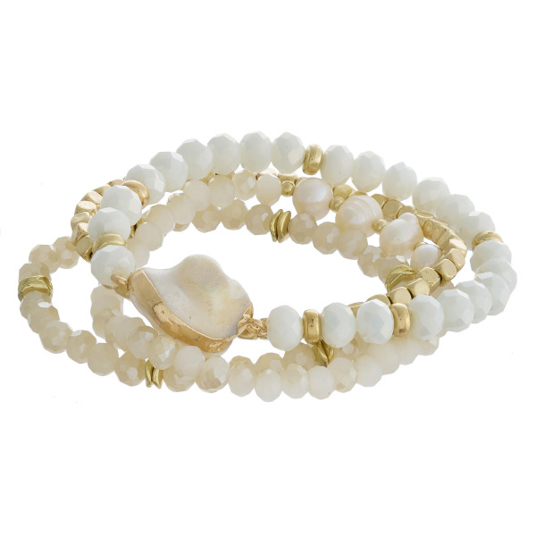 "Bracelet set featuring four beaded stretch bracelets with faux pearls, faceted bead details and gold metal accents. Approximately 3"" in diameter unstretched. Fits up to a 6"" wrist."
