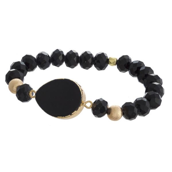 "Beaded stretch bracelet featuring a natural stone inspired focal with faceted bead details and gold accents. Approximately 3"" in diameter unstretched. Fits up to a 6"" wrist."