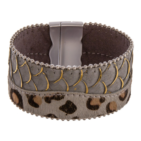 """Faux leather bracelet featuring animal print and scale details with a magnetic closure. Approximately 2"""" in diameter unstretched. Fits up to a 5"""" wrist."""