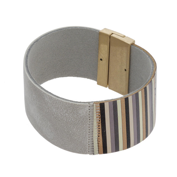 """Faux leather bracelet featuring a magnetic closure. Approximately 2.5"""" in diameter. Fits up to a 5"""" wrist."""