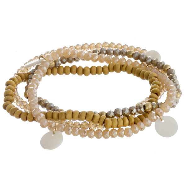 "Beaded bracelet set featuring four beaded bracelets with wood and faceted bead details and mother of pearl accents. Approximately 3"" in diameter unstretched. Fits up to a 6"" wrist."