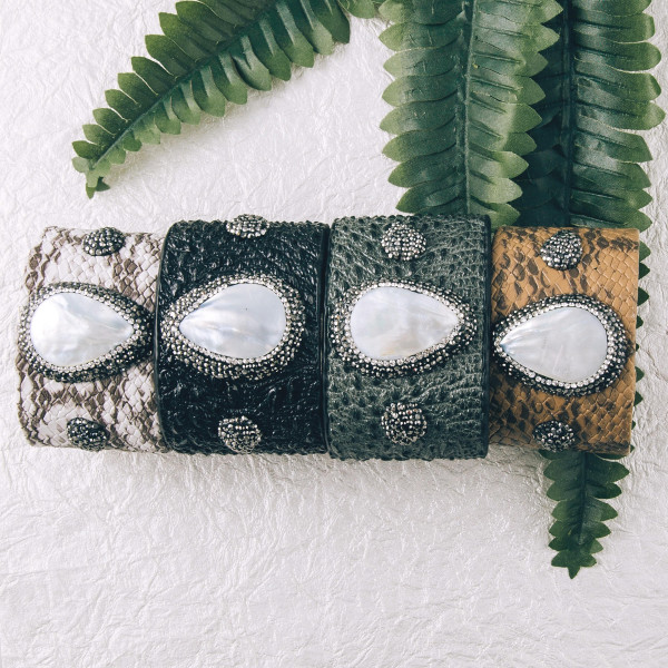 """Alligator faux leather cuff bracelet featuring a druzy natural stone focal with rhinestone details. Approximately 2.5"""" in diameter. Fits up to a 5"""" wrist."""
