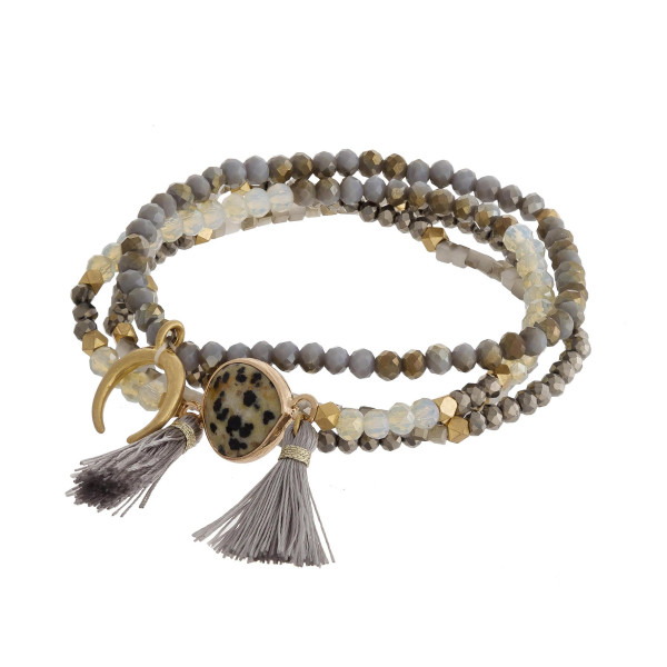 """Bracelet set featuring four stretch beaded bracelets with a natural stone focal, a crescent detail and tassel accents. Approximately 2.5"""" in diameter unstretched. Fits up to a 5"""" wrist."""