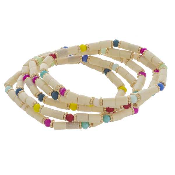 "Bracelet set featuring five beaded stretch bracelets with wood beads and multicolor accents. Approximately 2"" in diameter unstretched. Fits up to a 5"" wrist."