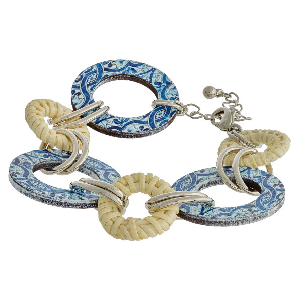 """Chain linked bracelet featuring rattan, metal, and wood accents. Approximately 2"""" in diameter with a 1.5"""" extender."""