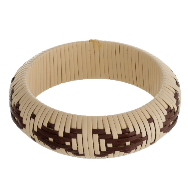 "Rattan woven wrapped bangle bracelet featuring a western inspired pattern. Approximately 3"" in diameter. Fits up to a 6"" wrist."