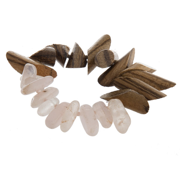 """Stretch bracelet featuring wood and resin inspired beaded details. Approximately 3"""" in diameter unstretched. Fits up to a 6"""" wrist."""