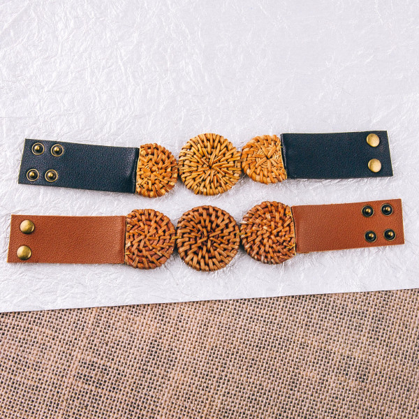 "Genuine leather bracelet featuring a rattan woven disc focal with a snap button closure. Approximately 3"" in diameter. Band width 1"". Fits up to a 6"" wrist."