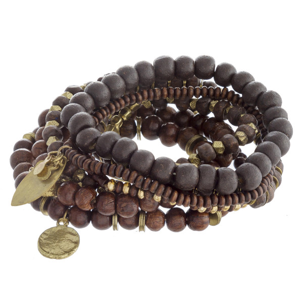 """Bracelet set featuring eight beaded stretch bracelets with wood bead details and gold metal accents. Approximately 3"""" in diameter unstretched. Fits up to a 6"""" wrist."""