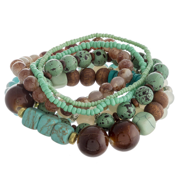 "Bracelet set featuring eight natural stone, wood beaded details and gold metal accents. Approximately 3"" in dimeter unstretched. Fits up to a 6"" wrist."
