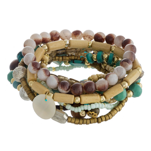 "Bracelet set featuring eight natural stone, wood beaded details with gold metal accents. Approximately 3"" in diameter unstretched. Fits up to a 6"" wrist."