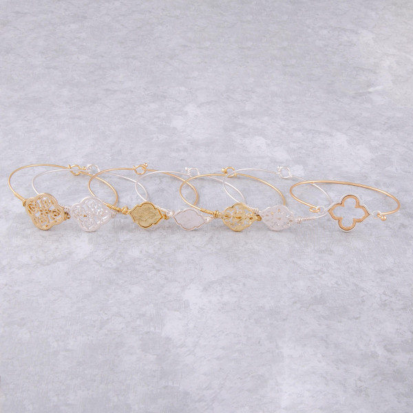 """Dainty bangle bracelet featuring a metal pattern inspired focal with wire wrapped details. Approximately 2.5"""" in diameter. Fits up to a 5"""" wrist."""