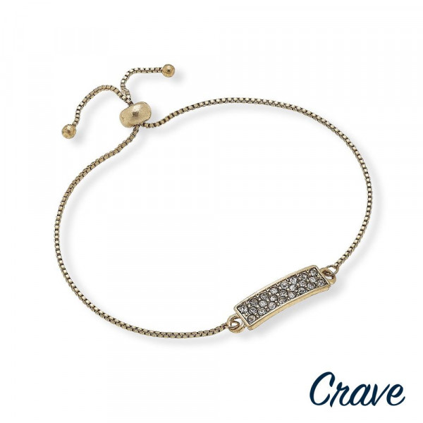"""Dainty bolo bracelet featuring a bar focal with cubic zirconia details and a adjustable closure. Approximately 3"""" in diameter. Fits up to a 6"""" wrist."""