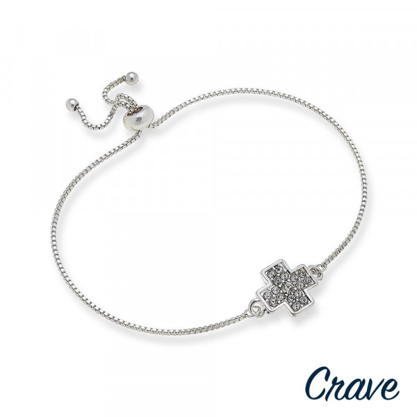 "Dainty bolo bracelet featuring a cross focal with cubic zirconia details and a adjustable closure. Approximately 3"" in diameter. Fits up to a 6"" wrist."