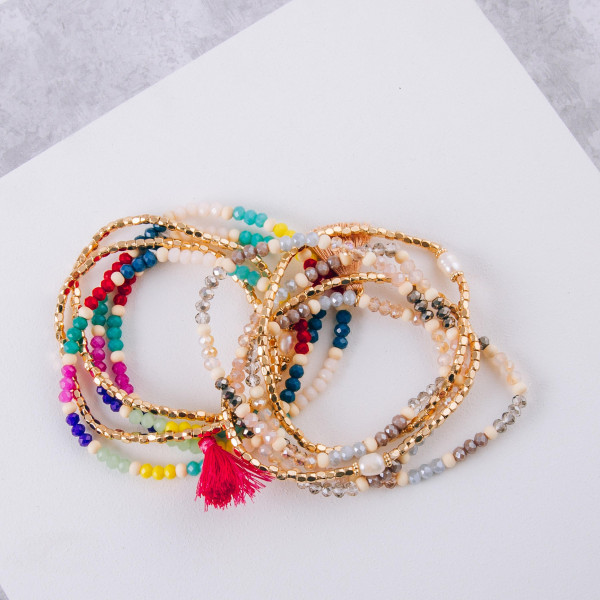 "Beaded stretch bracelet set featuring multicolor faceted and wood bead details with gold, tassel and pearl accents. Approximately 3"" in diameter unstretched. Fits up to a 6"" in wrist."