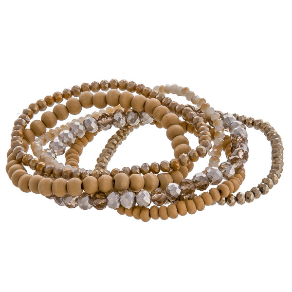 """Bracelet set featuring six beaded stretch bracelets with faceted and wood bead details. Approximately 3"""" in diameter unstretched. Fits up to a 6"""" wrist."""