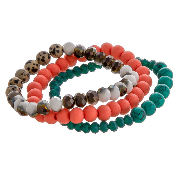 "Trio stretch bracelet set featuring natural stone, iridescent, and wood inspired bead details. Approximately 3"" in diameter unstretched. Fits up to 6"" wrist."