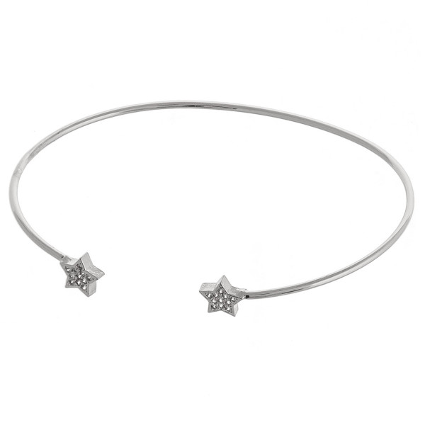 "Dainty metal cuff bracelet featuring star accents with cubic zirconia details. Approximately 3"" in diameter. Fits up to a 6"" wrist."