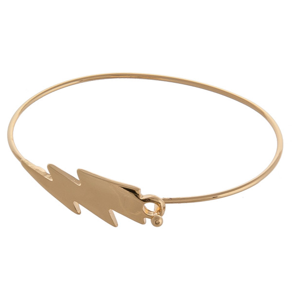 "Dainty metal bangle bracelet featuring a lightning bolt focal. Approximately 3"" in diameter. Fits up to a 6"" wrist."