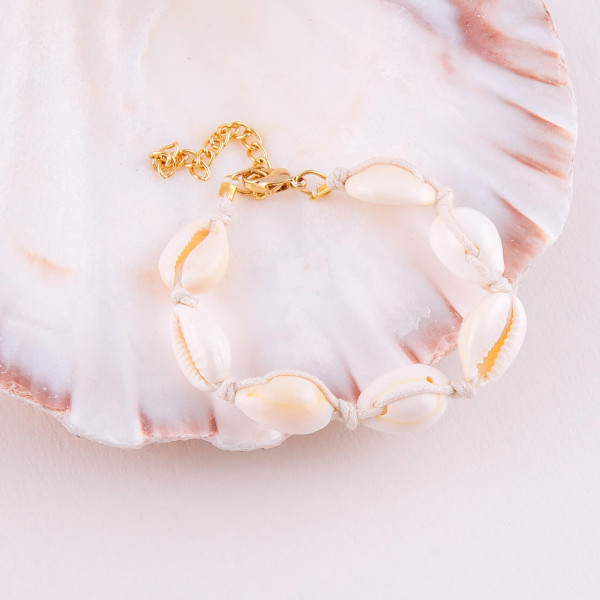 """Puka shell anklet. Approximately 4"""" in diameter. Fits up to a 8"""" anklet."""