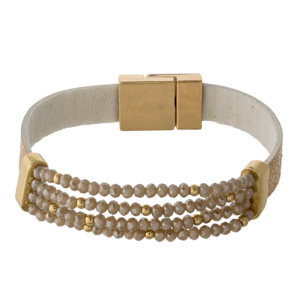 """Faux leather bracelet featuring a stretchy beaded detail with a magnetic closure. Approximately 3"""" in diameter. Fits up to a 6"""" wrist."""
