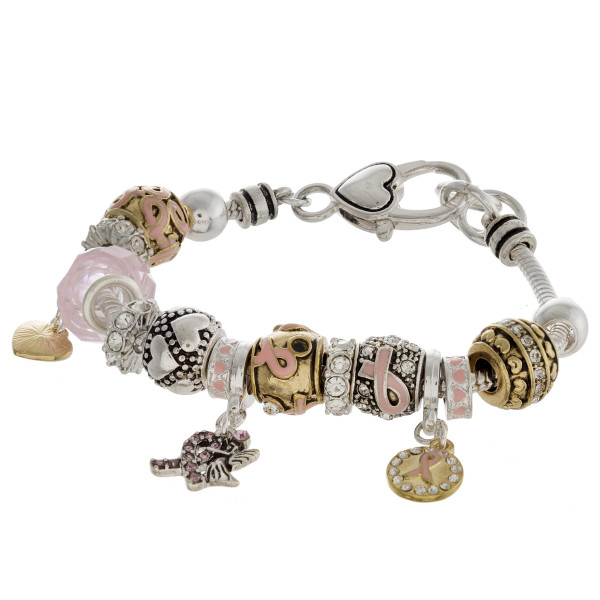 """Pandora inspired breast cancer awareness charm bracelet with a lobster clasp closure. Approximately 3"""" in diameter. Fits up to a 6"""" wrist."""