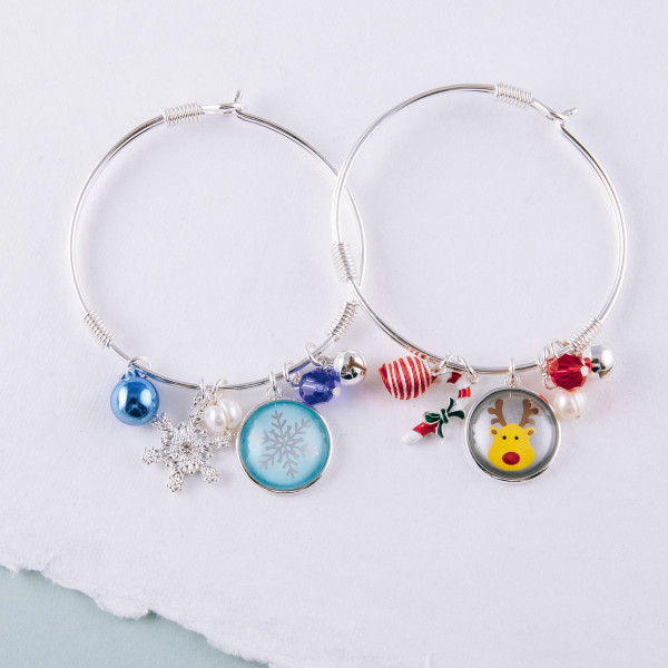"""Reindeer dome jingle charm bangle bracelet. Approximately 2.5"""" in diameter. Fits up to a 5"""" wrist."""