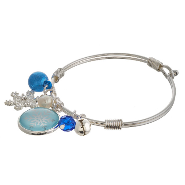 """Snowflake dome jingle charm bangle bracelet. Approximately 2.5"""" in diameter. Fits up to a 5"""" wrist."""