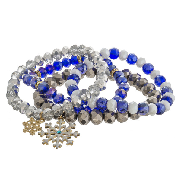 """Snowflake beaded stretch bracelet set of four. Approximately 3"""" in diameter. Fits up to a 6"""" wrist."""