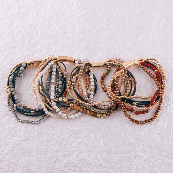 """Multi-strand bracelet featuring natural stone and iridescent bead details with gold accents and a magnetic closure. Approximately 3"""" in diameter. Fits up to a 6"""" wrist."""