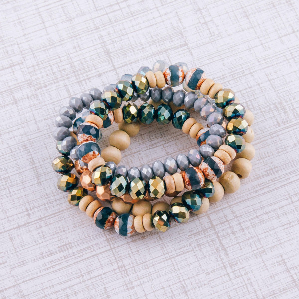 """Bracelet set featuring five beaded stretch bracelets with wood, natural stone, and iridescent bead details. Approximately 3"""" in diameter unstretched. Fits up to a 6"""" wrist."""