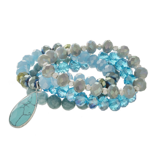 """Semi precious beaded stretch bracelet set featuring a natural stone teardrop charm with faceted bead details. Approximately 3"""" in diameter unstretched. Fits up to a 6"""" wrist."""