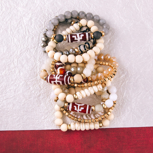"Acrylic beaded stretch bracelet set featuring natural stone and gold bead details. Approximately 3"" in diameter unstretched. Fits up to a 6"" wrist."