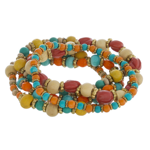 "Beaded boho stretch bracelet set featuring natural stone and wood inspired bead details with gold metal accents. Approximately 3"" in diameter unstretched. Fits up to a 6"" wrist."
