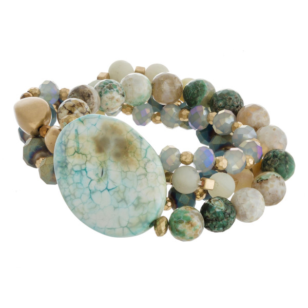 "Semi precious beaded stretch bracelet set featuring a natural stone focal with faceted, acrylic and gold bead details. Approximately 3"" in diameter unstretched. Fits up to a 6"" wrist."