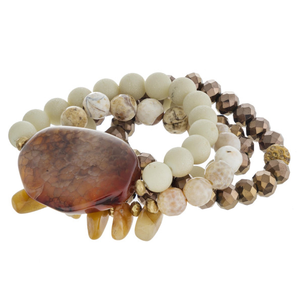 """Semi precious beaded stretch bracelet set featuring a natural stone inspired focal. Approximately 3"""" in diameter. Fits up to a 6"""" wrist."""