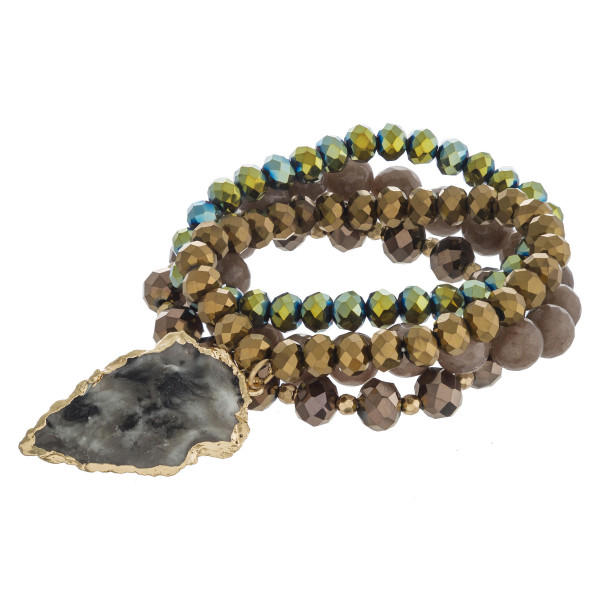 """Beaded stretch bracelet set featuring acrylic and faceted bead details with a natural stone inspired arrowhead charm. Charm approximately 1.5"""". Approximately 3"""" in diameter unstretched. Fits up to a 6"""" wrist."""