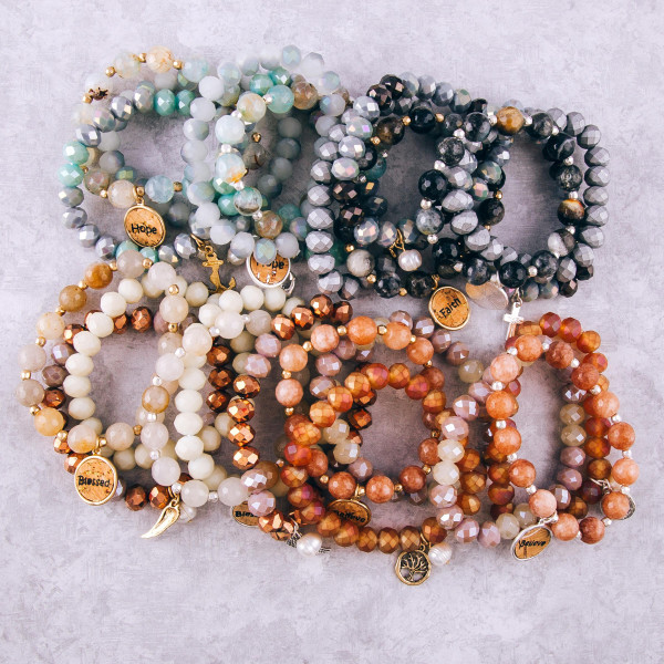 """Smokey Mint faceted acrylic beaded stretch bracelet set featuring a cork """"Hope"""" charm with a gold anchor and pearl accent. Approximately 3"""" in diameter unstretched. Fits up to a 6"""" wrist."""