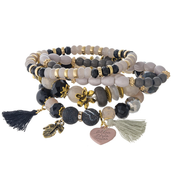 """Natural stone inspired charm stretch bracelet set featuring faceted bead details, gold and tassel accents with """"Bliss this Miss"""" engraved message. Approximately 3"""" in diameter unstretched. Fits up to a 6"""" wrist."""