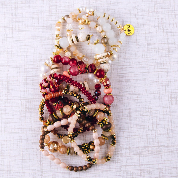 """Brown beaded stretch bracelet set featuring natural stone, iridescent and faceted bead details with gold bead accents. Approximately 3"""" in diameter unstretched. Fits up to a 6"""" wrist."""