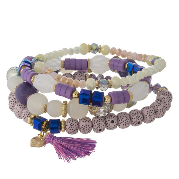 """Natural stone, iridescent and faceted beaded stretch bracelet set featuring lava and plastic bead details with tassel accents. Approximately 3"""" in diameter unstretched. Fits up to a 6"""" wrist."""
