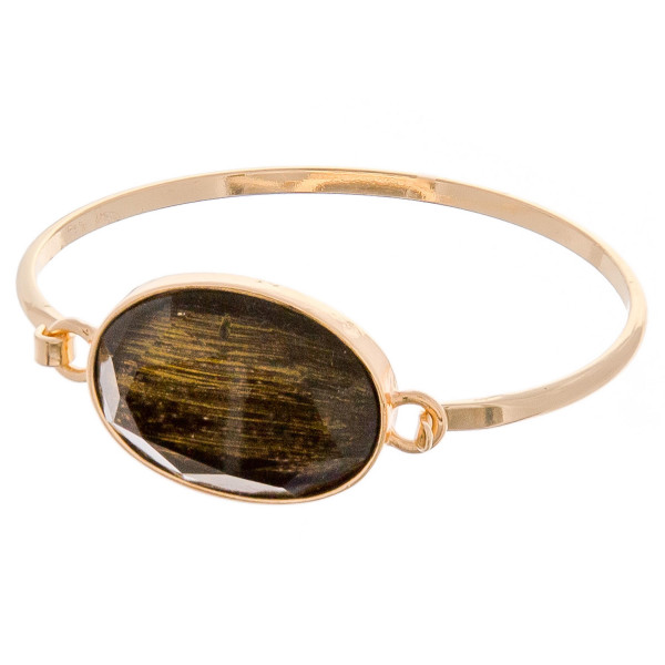 "Metal bangle bracelet featuring a iridescent acrylic focal. Approximately 3"" in diameter. Fits up to a 6"" wrist."