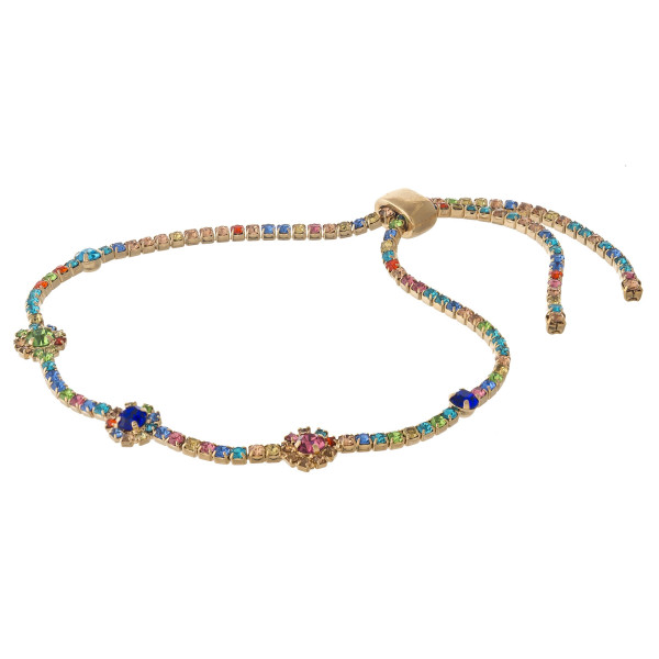 "Multicolor cubic zirconia bracelet featuring flower accents with an adjustable slider closure. Approximately 3"" in diameter. Fits up to a 6"" wrist."
