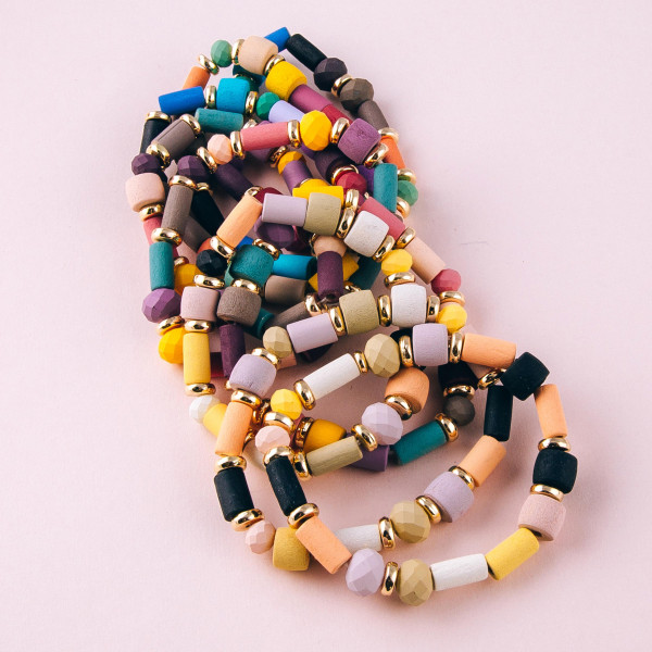 """Acrylic beaded stretch bracelet featuring faceted bead details and gold accents. Approximately 3"""" in diameter unstretched. Fits up to a 6"""" wrist."""
