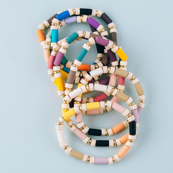 """Wood inspired color block stretch bracelet. Approximately 3"""" in diameter unstretched. Fits up to a 6"""" wrist."""