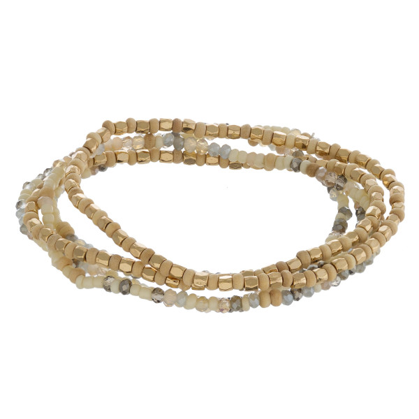 """Dainty beaded stretch bracelet set featuring wood, iridescent and gold bead details. Approximately 3"""" in diameter. Fits up to a 6"""" wrist."""