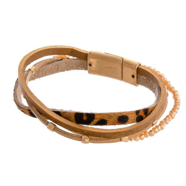 """Multi strand faux leather bracelet featuring leopard print, iridescent beaded details and gold accents with a magnetic closure. Approximately 3"""" in diameter. Fits up to a 6"""" wrist."""
